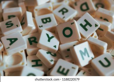 Bangkok, Thailand - September 25, 2018 : A pile of Scrabble letter tiles .