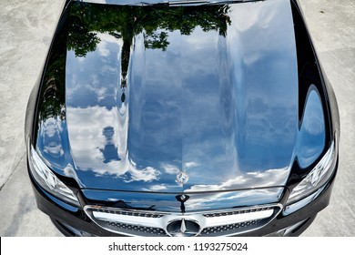 BANGKOK, THAILAND - SEPTEMBER 25, 2018: The Mercedes Benz E-Class Coupe with reflection of clear sky on hood/bonnet after paint polishing & coating. Illustration of car detailing and paint protection