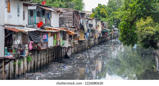 Bangkok, Thailand - September 25, 2018: slums along a smelly canal (Khlong Toei) full of mud and garbage in Khlong Toei District.