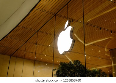 Bangkok, Thailand - September 25, 2018 : Apple symbol inside Store in Central District. Apple Inc. Apple Store cube on 5th Avenue on a cloudy rainy day.