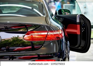 BANGKOK, THAILAND - SEPTEMBER 26, 2018: The Mercedes Benz E-Class Coupe with trunk reflection after paint polishing and coating. Illustration of car detailing and paint protection. Modern sport sedan
