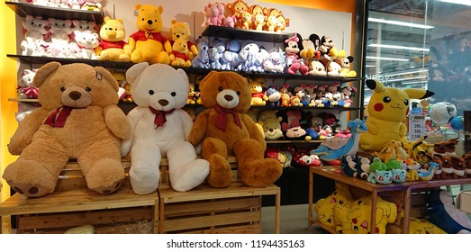 Bangkok, Thailand. September 26, 2018 - Plenty of children's toys displayed on sale in store, big teddy bear, pooh bear, mickey mouse, minnie mouse and pokemon dolls. stuffed animal cartoon dolls.