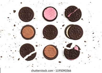 BANGKOK, Thailand - September 26, 2018: OREO cookies and cream in pieces of outside and inside crust on white background with vanilla, chocolate & strawberry cream with crusts and crumbs scattered
