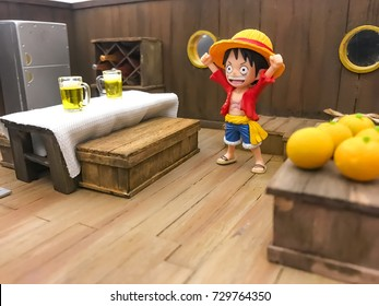 BANGKOK, THAILAND - SEPTEMBER 27, 2017 :  One piece status of Monkey D. Luffy fiberglass mini mascot model toy displayed in a kitchen room in a Pirate ship at cartoon model shop in Thailand.