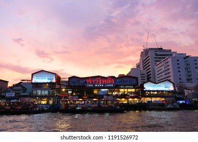 Bangkok, Thailand - September 27, 2018 : The atmosphere of the night light Wang Lang harbor on The Chao Phraya river.