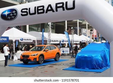 BANGKOK, THAILAND - SEPTEMBER 30, 2018:  A Subaru XV is displayed next to a covered car at Subaru Palm Challenge 2018 on September 30, 2018 in Bangkok, Thailand.
