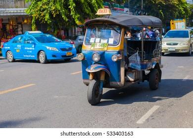 BANGKOK, THAILAND - SEPTEMBER 30: Tuk-Tuk on Yaowarat road in Bangkok on September 30, 2016. Samlor or three wheel bike is one of must do in Bangkok trip.