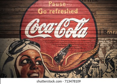 BANGKOK -THAILAND, September 3,2017 : Old condition vintage wall of Coca-Cola logo at museum  Ban Bang Khen in Bangkok Thailand.