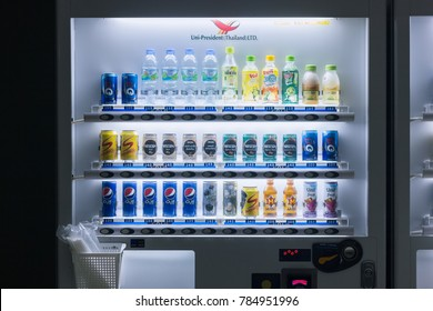 BANGKOK, THAILAND - SEPTEMBER 7, 2017 : Beverage vending machine selling Pepsi and water bottle in the university at night, soft drink and energy drink are very popular in Thailand as the rising