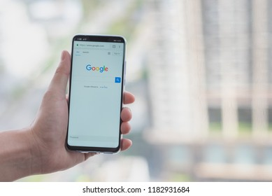 Bangkok, Thailand - September 7 2018: Close up a man hand hold Huawei Nova 3 Phone for searching on google with blurred background. To use searching information from internet.