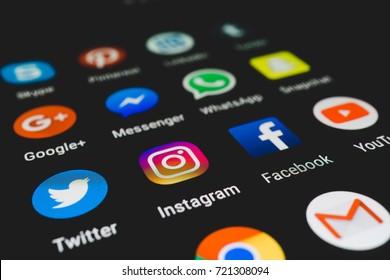 BANGKOK, THAILAND - September 8, 2017 : Set of social media application icons on smartphone screen close-up.