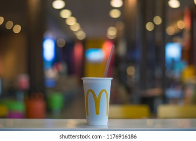 Bangkok, Thailand - September 9, 2018 : A cup of Coca cola with McDonald's logo in the McDonald's restaurant.