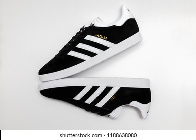 BANGKOK, THAILAND - SEPTEMBER 9, 2018 : : Original Adidas Gazelle running shoes, sneakers, trainers shows the logo on white background. Sport and casual footwear concept.
