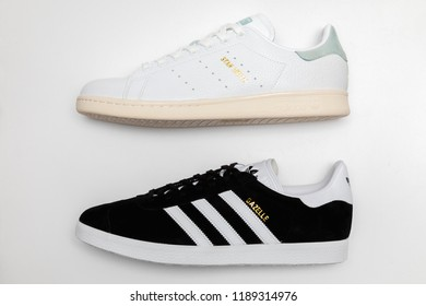 BANGKOK, THAILAND - SEPTEMBER 9, 2018 : : Original Adidas Gazelle running and stan smith tennis shoes, sneakers shows the logo on white background. Sport and casual footwear concept.