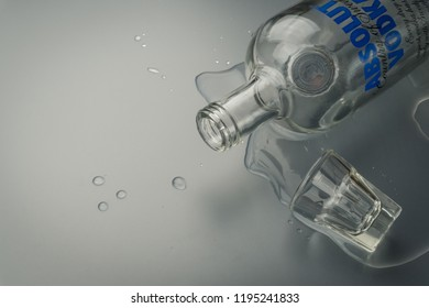 BANGKOK, THAILAND - SEPTEMBER 9, 2018: close up of the Absolut Vodka bottle and a shot glass. Absolut Vodka is a brand from Sweden.
