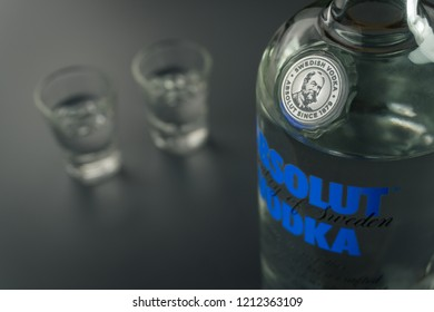 BANGKOK, THAILAND - SEPTEMBER 9, 2018: close up of the Absolut Vodka bottle and the shot glasses. Absolut Vodka is a brand from Sweden.