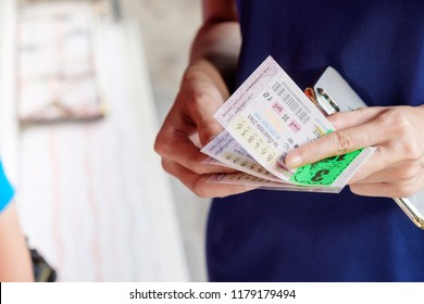 BANGKOK, THAILAND - September 9: Ladprao Intersection road on September 9,2018 in Bangkok, Thailand. Woman hand holding Thai lottery ready for sale in the market.