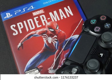 BANGKOK, THAILAND - SEPTEMBER 9:  The New Ps 4 Marvel Spiderman game with the Controller on  September 9,2018