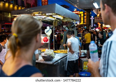 Bangkok, Thailand, Sunday 11 August 2019 : tourists interested in famous street food deep-fried dough stick Michelin guide shop or Chinese donut in China town at Yaowarat road