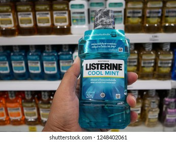 BANGKOK, THAILAND-2 DECEMBER 2018:Closeup hand man holding Listerine product Mouthwash for sale on the supermarket.