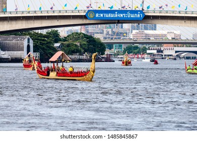 Bangkok, Thailand-2019-08-22: Bangkok, Thailand-2019-08-22: Rehearsal of the royal barges procession on Chao Phraya River under the Somdet Phra Pinklao Bridge