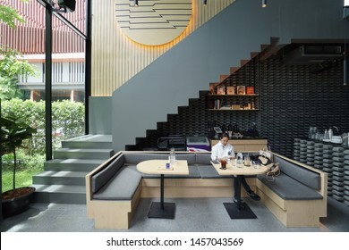 BANGKOK, THAILAND-21 July 2019 : KAIZEN COFFEE at Bangkok Thailand. Modern black and gray and light timber interior design.Elevation view with stair to second floor.