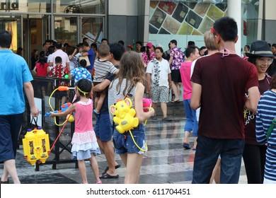 BANGKOK THAILAND-APRIL 13:Bangkok Songkran festival.Thai people and tourists come to join festival at Central world Rachaprasong Rd. on April 13,2016 in Bangkok, Thailand.