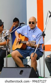BANGKOK, THAILAND-APRIL 7:Unidentified musician perform at Red Cross hall on the Bangkok on the street festival,On April 7, 2012 in Bangkok, Thailand.
