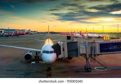 BANGKOK, THAILAND-AUG 23, 2017:Airport terminal Don Muang prepare luggage and goods for passenger transportation in sunrise. Bangkok, Thailand
