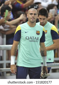 BANGKOK, THAILAND-AUGUST 06:Victor Valdes(L) of Barcelona FC in action during Barcelona FC training session at Rajamangala Stadium on August 06, 2013 in Bangkok,Thailand.
