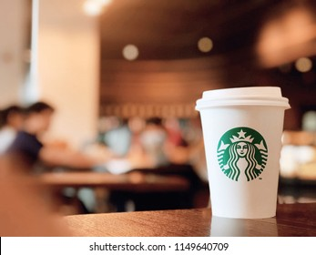 Bangkok ,Thailand-August 1 : Starbucks Hot beverage coffee on table on 1 August 2018 at The mall department store,bokeh background, Bangkok, Thailand. (Selection focus)