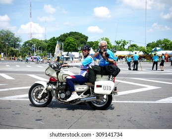 BANGKOK/ THAILAND-AUGUST 16: Bike for Mom activity in Thailand, Guinness Book of world records on August 16, 2015 in Bangkok. Reporter sits behind the motorcycle in taking photos.