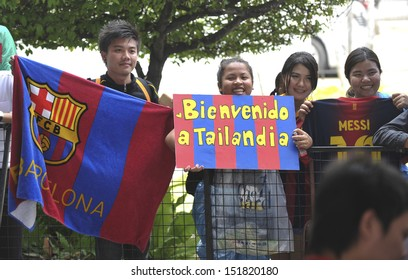 BANGKOK, THAILAND-AUGUST5:Fan Club team FC Barcelona with banners cheering came for the team in Barcelona at Don Muang airport on August 5, 2013 in Bangkok,Thailand.