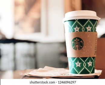 Bangkok ,Thailand-December 1 : Starbucks Hot beverage coffee on table on 1 December 2018 at The mall department store,bokeh background, Bangkok, Thailand. (Selection focus)