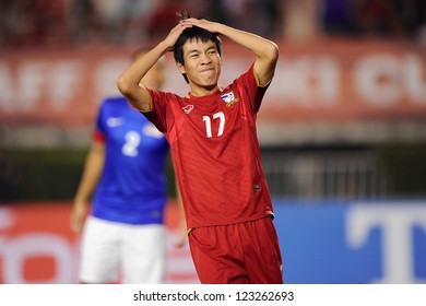 BANGKOK THAILAND-DECEMBER 13:Apipoo Suntornpanavej of Thailand (red) reacts during the AFF Suzuki Cup between Malaysia and Thailand at Supachalasai stadium on Dec13,2012 in ,Thailand.
