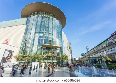 BANGKOK - THAILAND,December 20 2016 : The domestic and international tourists visit and shopping at Siam Paragon mall ,The front of the shopping center has a train path to accommodate tourists.