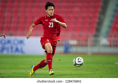 BANGKOK THAILAND-FEBRUARY 06:Piyapol Bantao (red) of Thailand in action during the football 2015 Asian Cup qualifying  between Thailand and Kuwait at Rajamangala stadium on Feb 06, 2013 in,Thailand.