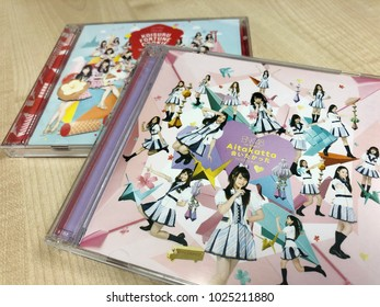 BANGKOK, THAILAND-FEBRUARY, 14: View of Single CD BNK48 Aitakatta and Koisuru Fortune Cookie on the Wooden Table on February 14,2018.