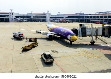 BANGKOK, THAILAND-FEBRUARY 19, 2017, nok air plane loading luggages and waiting flight in donmueang international airport with soft-focus and over light