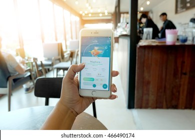 Bangkok, Thailand,in coffee shop - August 10, 2016 : Apple iPhone6 Plus held in one hand showing its screen with iPokemon Go gameplay screenshot on the phone application.