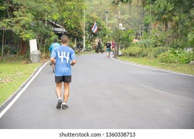BANGKOK, THAILAND-JAN 19,2019: People running and Jogging at Vachirabenjatas Park (Rot Fai Park) in morning on January 19, 2019 in Bangkok, Thailand.