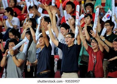 BANGKOK THAILAND-JAN15:Spectators watch and cheer of Korel Rep.in action during the 41st King's cup football between Thailand(Y)and KoreaRep(R)at Rajamangala stadium on Jan15,2012 in Bangkok,Thailand.