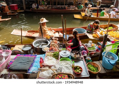 Bangkok, Thailand,January 23 01 2014:Bangkok floating market local food Thai vendors selling fruits fantastic beautiful place in Thailand