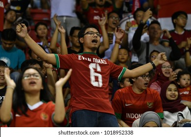 BANGKOK THAILAND-JUL 23 :Unidentified fans of Indonesia supporters during AFC U23 Championship China 2018 qualifiers against Indonesia at Supachalasai Stadium on July 23,2017 in Bangkok Thailand