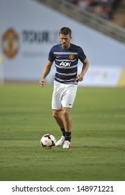 BANGKOK, THAILAND-JULY 12:Michael Carrick of Manchester United in action during a first team training pre-season tour of Bangkok at Rajmalanga Stadium on July 12, 2013 in Bangkok, Thailand.