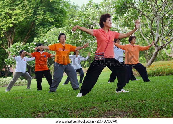 Bangkok, Thailand-July 24, 2014: Elderly Asian Exercise, Tai Chi for Health at the park in Bangkok,Thailand on July 24, 2014.