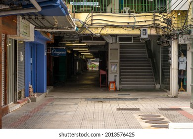 BANGKOK, THAILAND-JULY 24: Closed shops in Siam square during outbreak of Covid-19 on July 24,2021, Bangkok, Thailand. Siam square is a Famous shopping and entertainment area