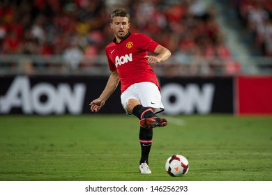 BANGKOK THAILAND-JULY13:Michael Carrick of Manchester United looks to pass during the friendly match between Singha All Star XI and Manchester United at Rajamangala Stadium on July13,2013 in Thailand.