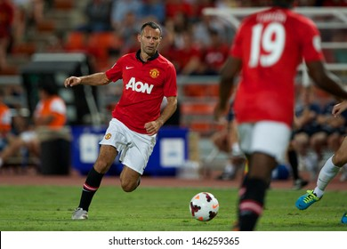 BANGKOK THAILAND-JULY13:Ryan Giggs of Manchester United run with the ball during the friendly match between Singha All Star XI and Manchester United at Rajamangala Stadium on July13,2013in Thailand.