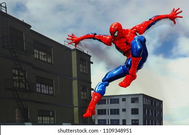 Bangkok, Thailand-June 10,2018: Spider-Man, an action figure from famous Marvel comics, jumping on the roof top.